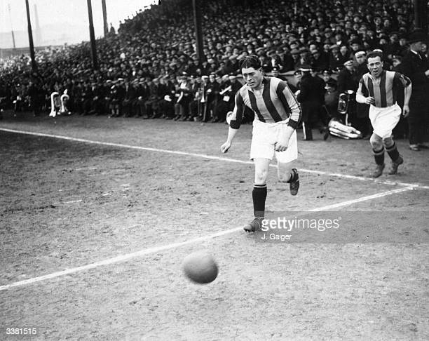 Hull Football Club captain, M Bell, leads his team out onto the pitch.