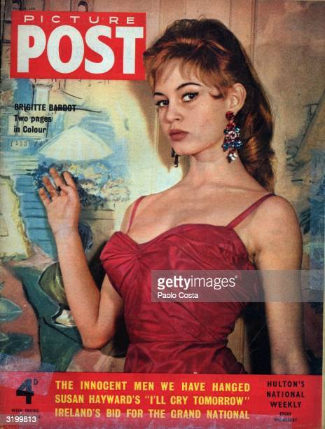 French actress Brigitte Bardot appears on the cover of Picture Post magazine in a red summer dress and extravagant earrings Original Publication...