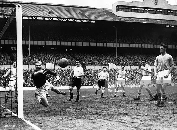 Manchester City's German goalkeeper acrobatically tips the ball around the post from a Tottenham Hotspur shot on goal at White Hart Lane
