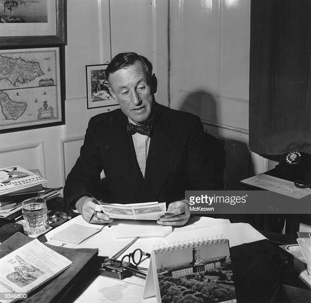 English novelist Ian Fleming best known for his character James Bond working in his study