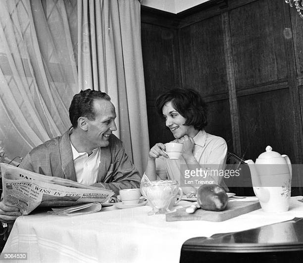 English boxer Henry Cooper with his wife Albina at home