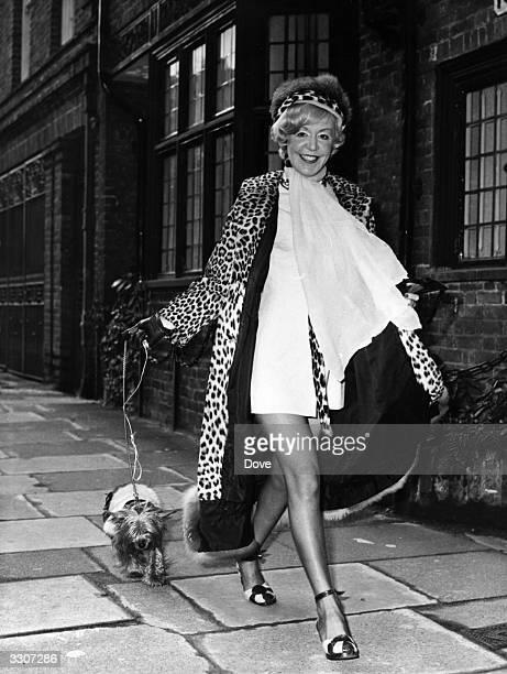 English singer Kathy Kirby walking her dog