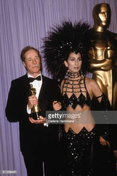 24th March 1986 American actor Don Ameche holds his Oscar while posing with American actor and singer Cher at the Academy Awards Ameche won Best...