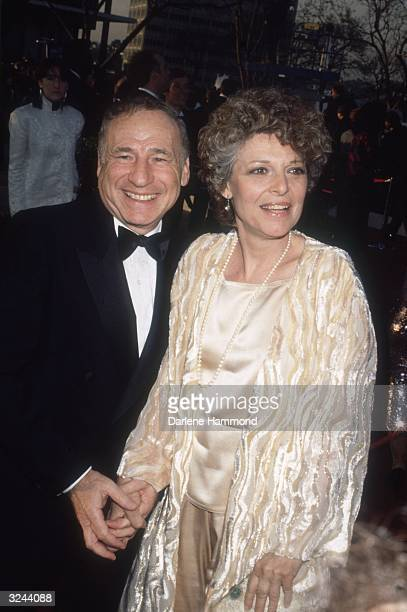 American comedic actor writer and director Mel Brooks smiles with his wife American actor Anne Bancroft while attending the Academy Awards Los...