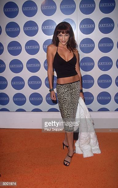 Fulllength image of actor Lauren Hays wearing a hiphugging leopard print skirt and black halter top at the Artisan Entertainment preOscar party West...