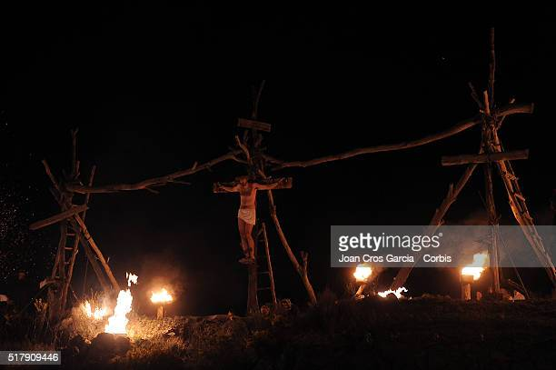 A man representing Jesus crucified during the Holy Week celebrations in Vilalba dels Arcs Spain 24th of March 2016