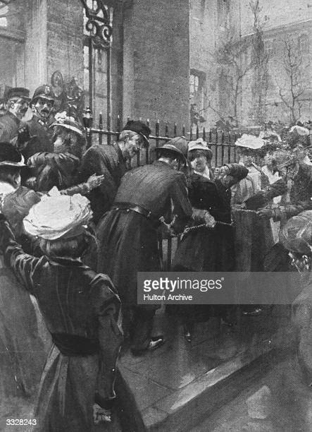 Policemen cut the chains of suffragettes who chained themselves to the railings at Downing Street London Original Publication Illustrated London News...