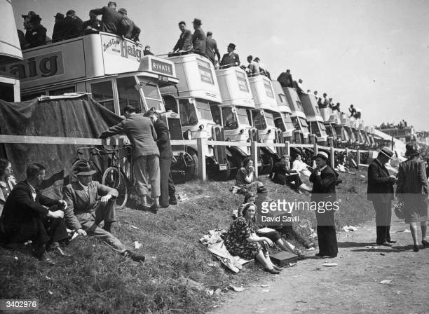 Line of buses on the course on Derby day at Epsom Racecourse.