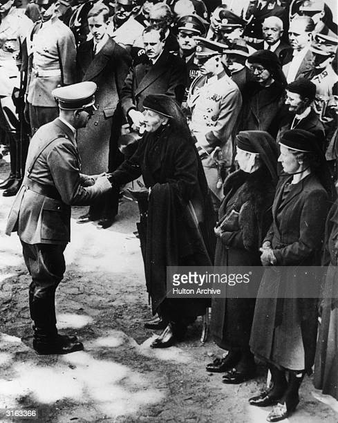 Adolf Hitler commiserates with mourners at the funeral of Count Von Der Schulenburg General of Cavalry at Potsdam Berlin