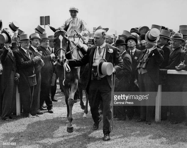 'Blue Peter', Eph Smith up being led in by Lord Rosebery after winning the Derby at Epsom.