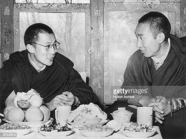 His Holiness the Dalai Lama of Tibet and the Panchen Lama seated and talking at a dining table Tibet