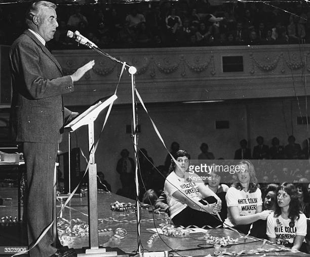 Gough Whitlam at a political rally during the Australian elections His tshirted followers listen to him as he addresses the audience from a streamer...
