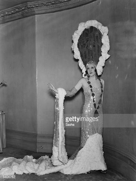 English romantic novelist Mrs A G McCorquodale as 'St Moritz', in costume for the Pageant of 'Famous Trains And Their Destinations', in aid of...