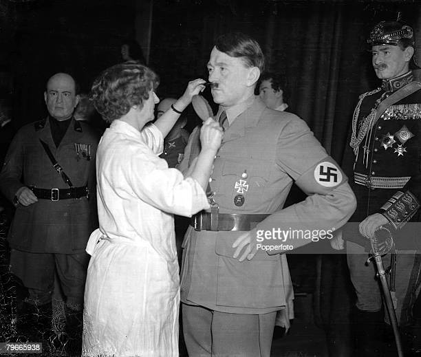 24th November 1938 London England A wax model of German Chancellor and Nazi dictator Adolf Hitler has his moustache combed by a Madame Tussauds...