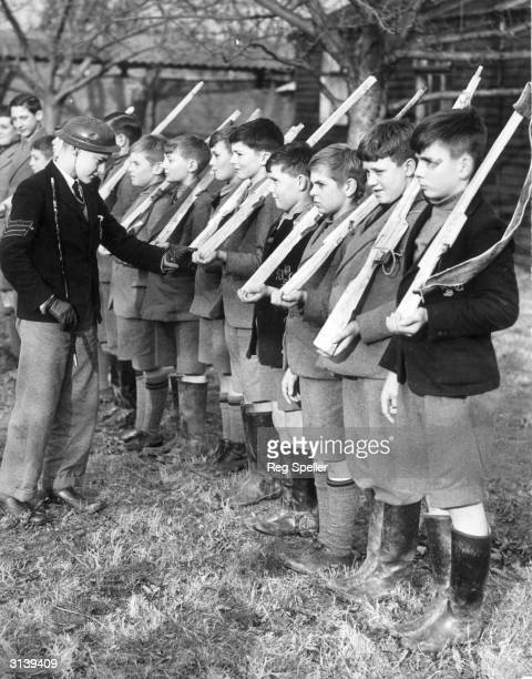 Young 'Sergeant Major' inspects some of the Dulwich College Preparatory schoolboys who have been evacuated to Kent at the start of WW II. The...