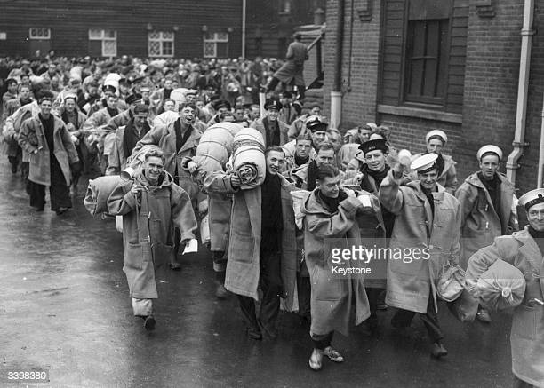 Surviving crew members of aircraft carrier HMS Ark Royal arriving in England