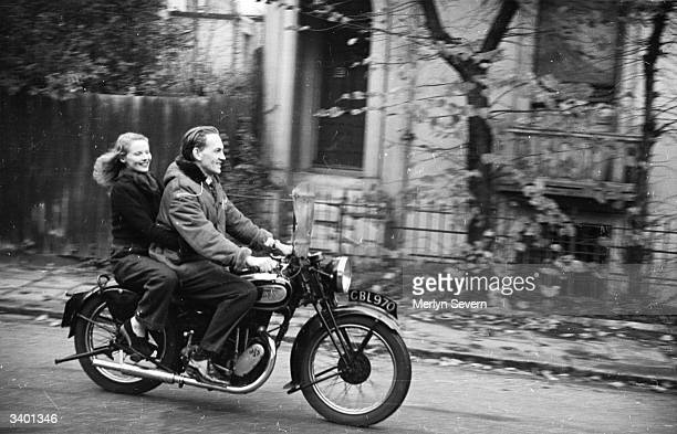 British actress Ann Todd riding pillion with her husband Wing Commander Nigel Tangye at the controls of a motorcycle Original Publication Picture...