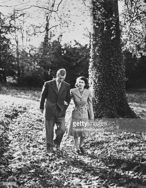 Princess Elizabeth and the Duke of Edinburgh on honeymoon at Broadlands near Romsey Hampshire walking on the Broadlands estate after a service in...