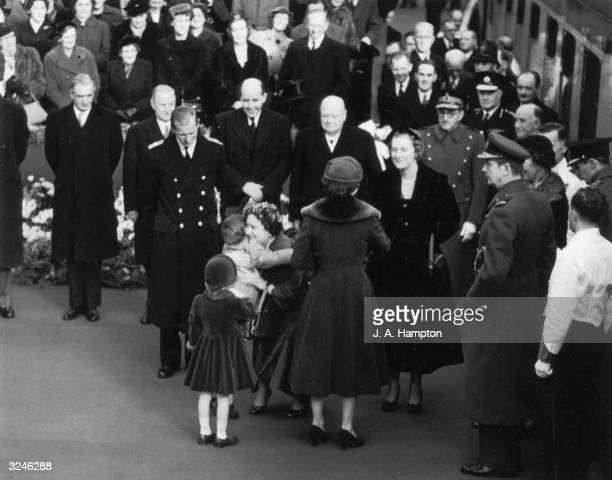 The Queen Mother arrives at Waterloo Station after her tour of Canada and is welcomed back with a hug from her grandson Prince Charles Also there to...