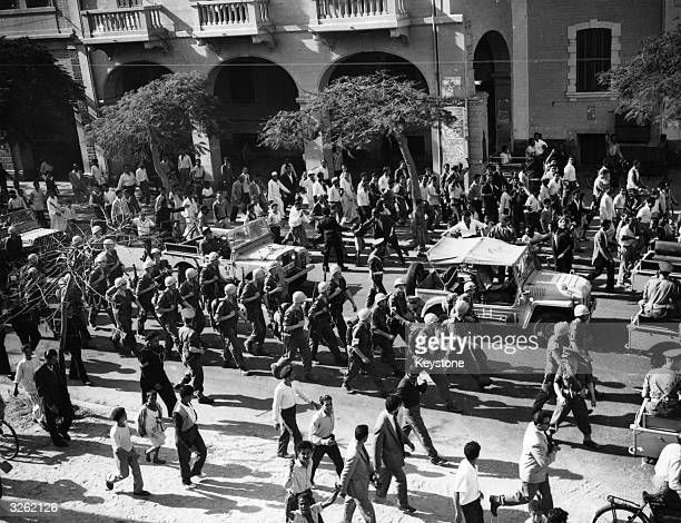 United Nations Forces march through the streets of Port Said during the Suez Crisis. British troops had to clear a way through the Egyptian crowds...