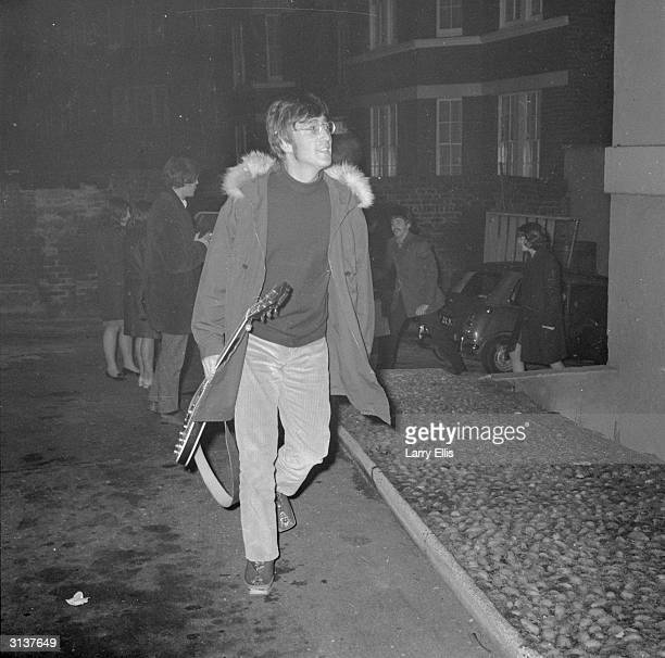 John Lennon of the Beatles arrives at the EMI studios in Abbey Road London