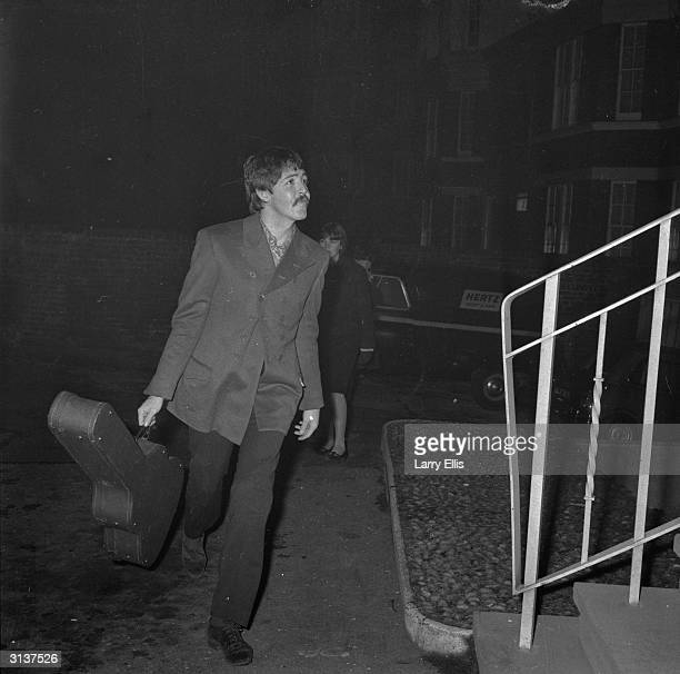Paul McCartney of the Beatles arrives at the EMI studios in Abbey Road London