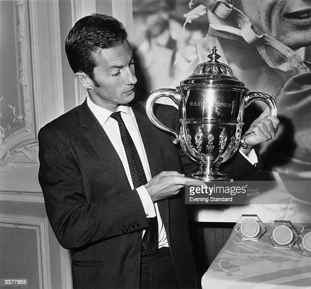 English jockey Lester Piggott holding the 'Daily Express' Cup