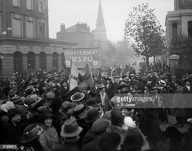 The Women's Freedom League demands the release of Women's Royal Air Force member Elsie Smith from Holloway Prison London The procession passes Holborn