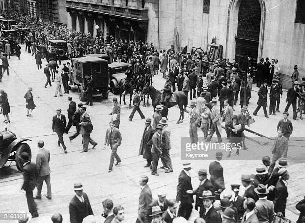 Anxious crowds waiting in front of the SubTreasury Building opposite the Stock Exchange during the Wall Street Crash