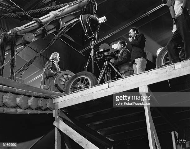Armenian born film director Rouben Mamoulian directing Swedish born American actress Greta Garbo in the film 'Queen Christina'