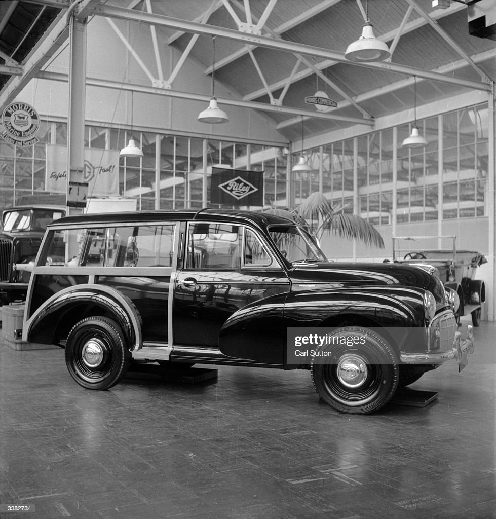 A Morris Traveller at a motor show. Original Publication: Picture Post - 6771 - German Diesel Car For The Motor Show - pub. 1953