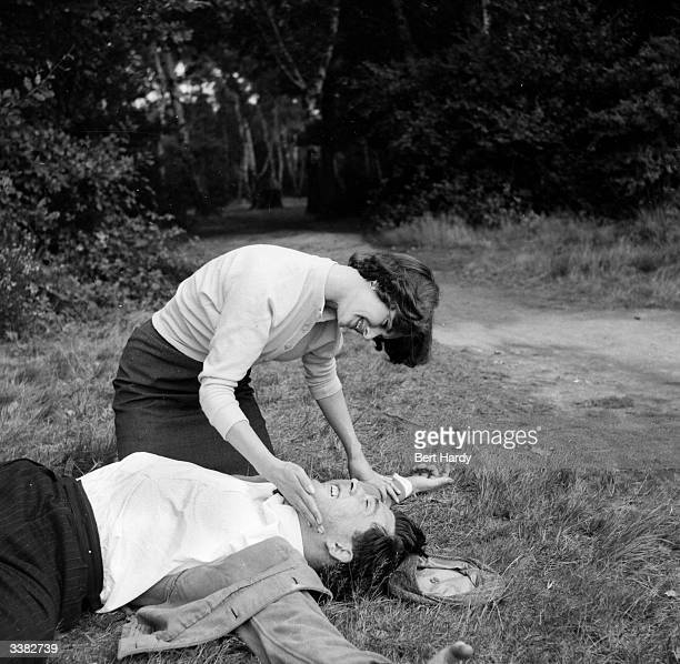 Eighteen year old Brenda Morn demonstrates effective Judo self defence techniques for women in the event of attack Here Brenda gives a Judo chop to...