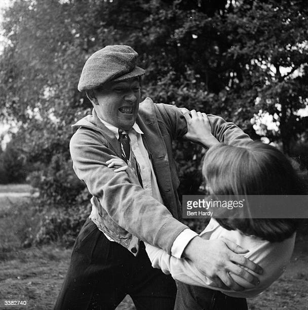 Eighteen year old Brenda Morn demonstrates effective Judo self defence techniques for women in the event of attack Here Brenda grips his sleeves and...