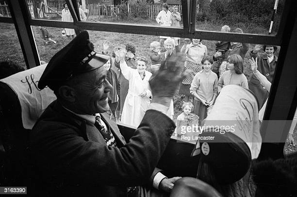 A man from the Atlantic Island of Tristan da Cunha waves goodbye to his friends and neighbours in England before returning home