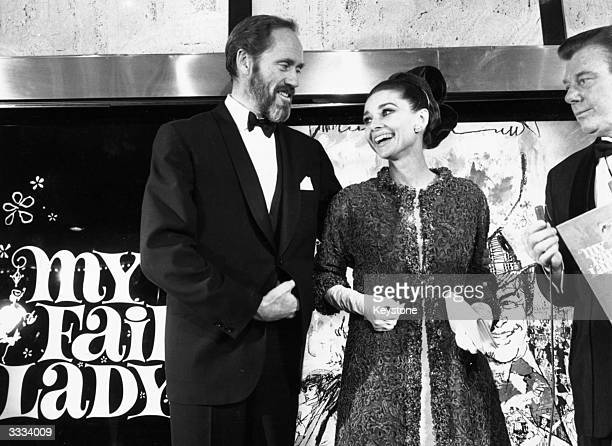 Film star husband and wife Audrey Hepburn and Mel Ferrer at the film premiere of 'My Fair Lady' Audrey Hepburn is wearing a Givenchy gown
