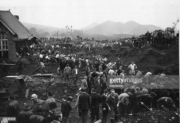 Helpers clearing debris and sludge near the wrecked Pantglas Junior School at Aberfan South Wales where a coal tip collapsed killing many children