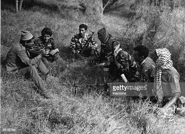 Anti-Israeli Palestinian guerrillas listening to their leader before an operation against Lebanese security forces during Arab against Arab conflict...
