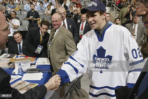 24th overall draft pick Alexander Steen, selected by Toronto Maple Leafs, is greeted by the team staff during the first round NHL Draft on June 22,...