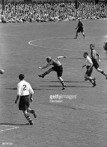 Wolves left half Billy Wright makes a sweeping pass as Wolverhampton Wanderers play Middolesbrough Original Publication Picture Post 4884 Are Wolves...