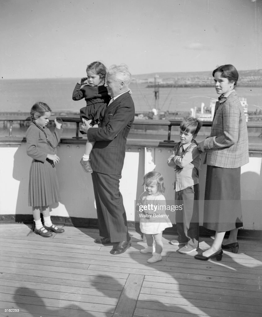 British-born comedian Charles Chaplin (1889 - 1977) and his family arrive at Cherbourg on board the Queen Elizabeth. His wife Oona (1926 - 1991) is the daughter of playwright Eugene O'Neill.