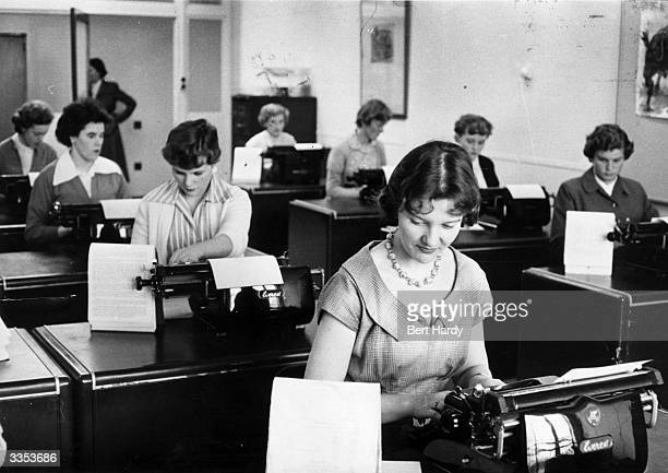 Women working hard in the typing pool at the Unilever company. Original Publication: Picture Post - 8002 - Leave Youth Alone - pub. 1955