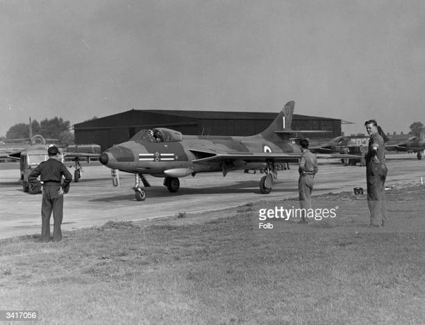 RAF mechanics watching a Hunter aircraft prepare for take off at Biggin Hill airfield in England