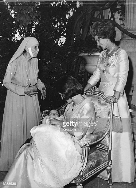 Baby Crown Princess Alexia of the Hellenes in the arms of her mother Queen AnneMarie of the Hellenes after her baptism in the royal palace at Athens...