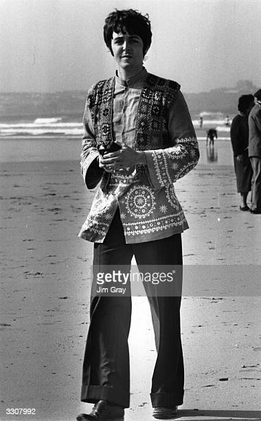 Paul McCartney singer and bass player with top British pop group The Beatles on the beach at Newquay Cornwall during the filming of 'The Magical...