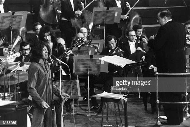 Composer and conductor Malcolm Arnold conducting British rock band 'Deep Purple' at the Royal Albert Hall in London Deep Purple's keyboardist and...
