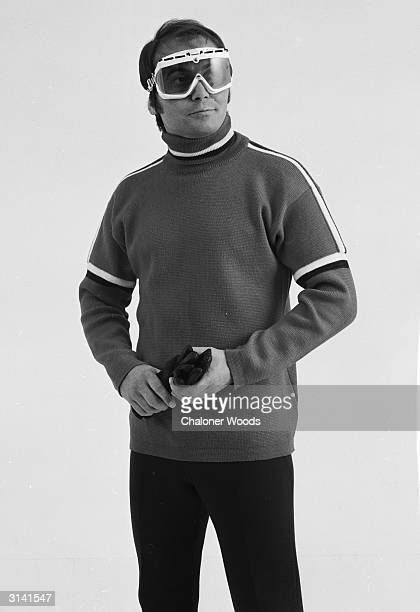 A sweater with stripes on the shoulder and sleeves worn with skiing goggles in a Gordon Lowe catalogue