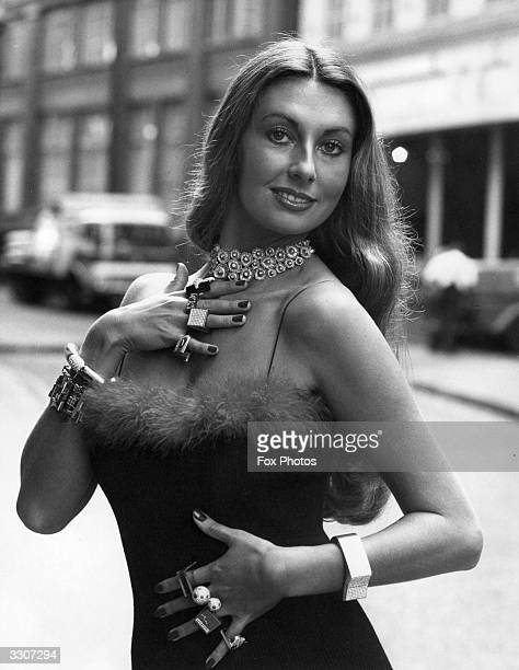 Model Marilyn Cole modelling a £50,000 necklace designed by Ernest Blyth, which won an award at the 1973 Diamond International Awards at Goldsmith's...