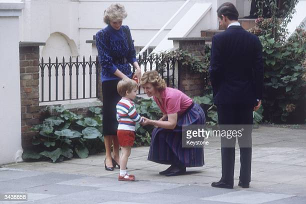 Diana Princess of Wales and Charles Prince of Wales introduce their three yearold son Prince William to headmistress Jane Mynors on William's first...