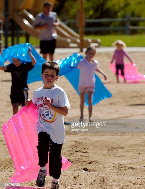 LAKEWOOD COSEPTEMBER 24TH2006Simon Castagneri <cq> 7yearsold <cq> leads other kids on a run back to the finish line of an obstacle course during...