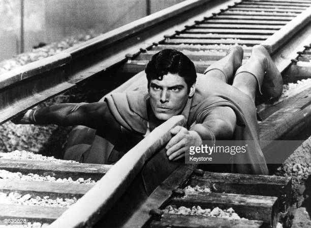 Year-old American actor Christopher Reeve plays the comic-book hero as he mends a broken railway track in a scene from the film 'Superman'.